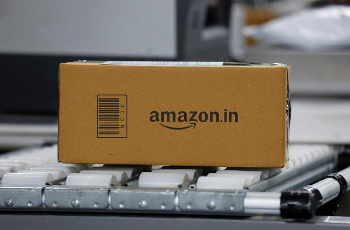 FILE PHOTO: A shipment moves on a conveyor belt at an Amazon Fulfillment...