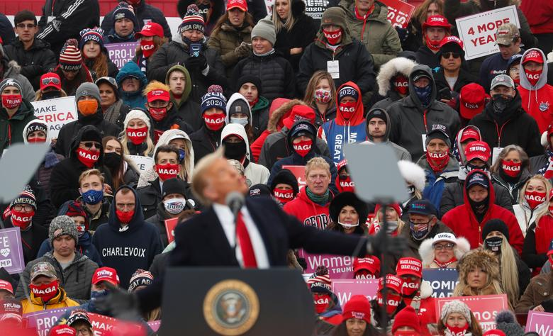 Supporters watch as President Trump speaks during a campaign rally in Waterford Township, Michigan, October 30. REUTERS/Shannon Stapleton