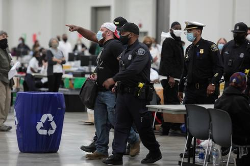 Poll challengers escorted out of Detroit vote-counting center