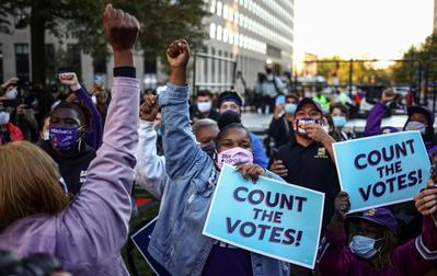 Americans rally to 'protect the vote' amid election cliffhanger