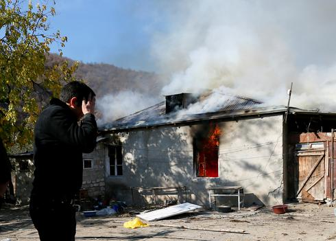 Armenians set fire to homes before handing villages over to Azerbaijan