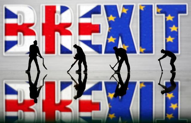 FILE PHOTO: Small toy figures are seen in front of a Brexit logo in this illustration picture, March 30, 2019. REUTERS/Dado Ruvic/Illustration