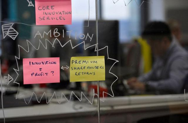 Post-it notes are displayed in the UBS ''fintech lab'' at Canary Wharf in London, Britain, October 19, 2016.
