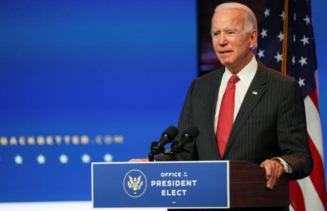 FILE PHOTO: U.S. President-elect Joe Biden speaks to reporters following an online meeting with members of the National Governors Association (NGA) executive committee in Wilmington, Delaware, U.S., November 19, 2020. REUTERS/Tom Brenner