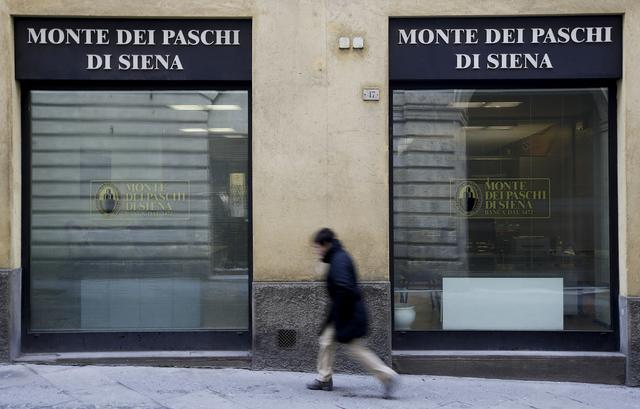 FILE PHOTO: A man walks in front of the Monte dei Paschi bank in Siena, central Italy, January 29, 2016. REUTERS/Max Rossi/File Photo