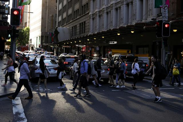 FILE PHOTO: People walk through a congested intersection in the city centre of Sydney, Australia, November 9, 2020.  REUTERS/Loren Elliott