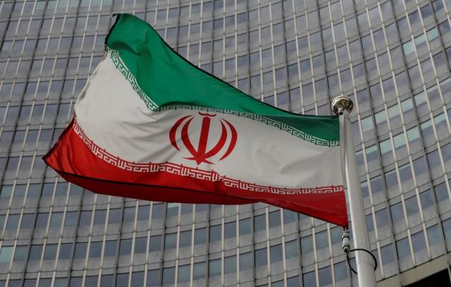 FILE PHOTO: An Iranian flag flutters in front of the International Atomic Energy Agency (IAEA) headquarters in Vienna, Austria September 9, 2019.   REUTERS/Leonhard Foeger