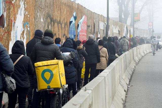 Queues form outside Milan food banks as crisis bites ahead of Christmas | Reuters