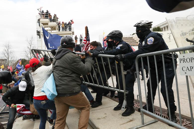 Supporters of President Trump clash with police officers outside of the U.S. Capitol Building in Washington, January 6. REUTERS/Leah Millis