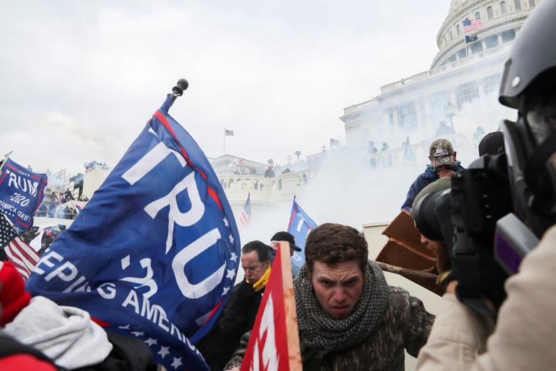 Supporters of President Trump clash with police officers in front of the Capitol Building, January 6. REUTERS/Leah Millis