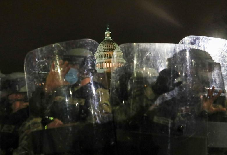 Members of the National Guard stand guard outside the Capitol Building, January 6.  REUTERS/Leah Millis