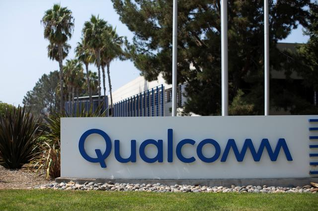 FILE PHOTO: A Qualcomm sign is shown outside one of the company's many buildings in San Diego, California, U.S., September 17, 2020. REUTERS/Mike Blake