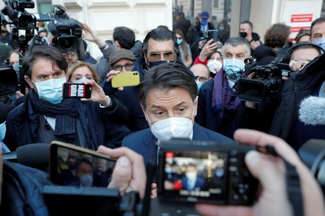 Italian Prime Minister Giuseppe Conte speaks to the media outside his office, Chigi Palace, after meeting with President Sergio Mattarella, in Rome, Italy, January 13, 2021. REUTERS/Remo Casilli