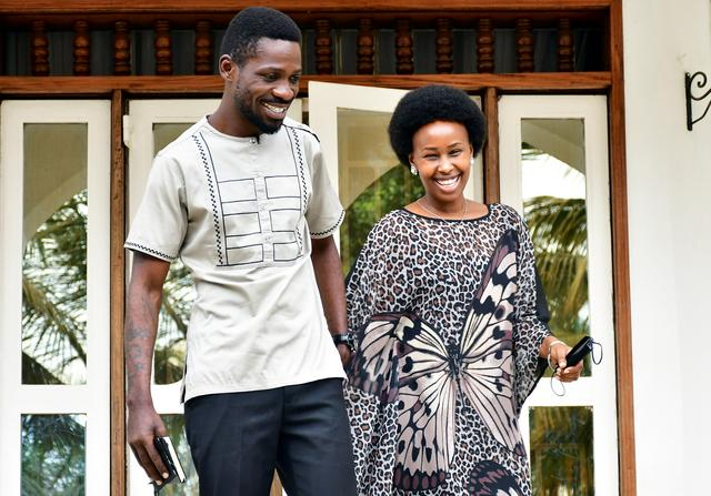 Ugandan presidential candidate and singer Robert Kyagulanyi Ssentamu, known as Bobi Wine, and his wife Barbara Itungo, leave their house before casting their ballots in the presidential elections in Kampala, Uganda, January 14, 2021. REUTERS/Abubaker Lubowa