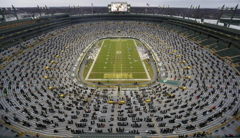 About 8,000 fans attend the Green Bay Packers playoff against the Los Angeles Rams on Jan. 16, at Lambeau Field in Green Bay, Wisconsin. Due to the coronavirus pandemic, this was the first time during the 2020 season that any season-ticket holders were able to attend a game at Lambeau Field. Sarah Kloepping-USA TODAY NETWORK