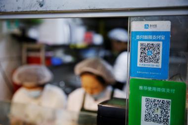 焦点:中国央行对非银支付反垄断 支付宝、微信市场支配地位能否认定存疑