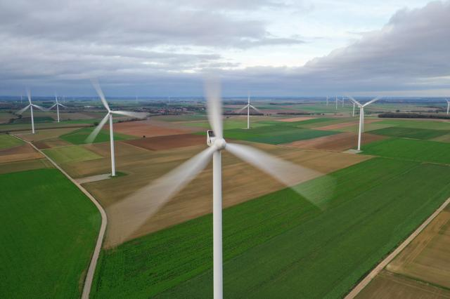 FILE PHOTO: An aerial view shows power-generating windmill turbines in a wind farm in Morchies, France, November 8, 2020. Picture taken with a drone REUTERS/Pascal Rossignol/File Photo
