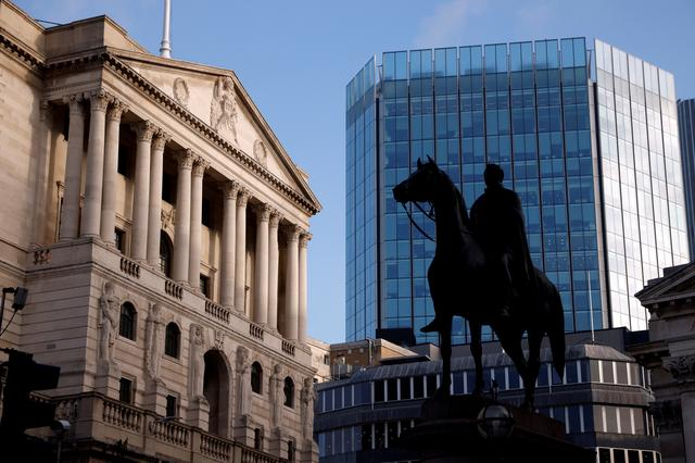 FILE PHOTO: A general view shows The Bank of England in the City of London financial district in London, Britain, November 5, 2020. REUTERS/John Sibley/File Photo