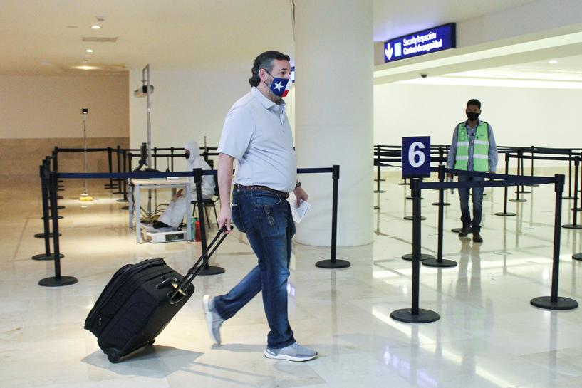 Image result for After blizzard of criticism over Mexico trip, Senator Ted Cruz flies back to frozen Texas