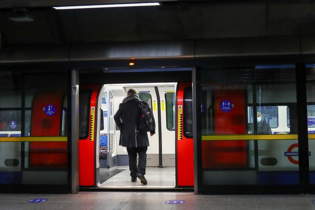 FILE PHOTO: A person enters almost deserted underground train at Waterloo station, amid the coronavirus disease (COVID-19) outbreak, in London, Britain, January 5, 2021. REUTERS/Hannah McKay/File Photo