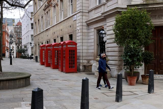 FILE PHOTO: People walk along a deserted street in Covent Garden amid the coronavirus disease (COVID-19) pandemic in London, Britain, January 10, 2021.   REUTERS/Kevin Coombs/File Photo