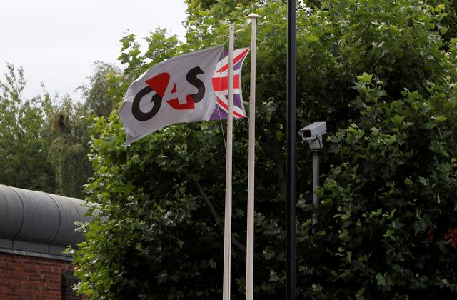 FILE PHOTO: Flags fly outside HMP Birmingham after the British government took over its running from G4S, in Birmingham, Britain August 20, 2018.  REUTERS/Darren Staples/File Photo