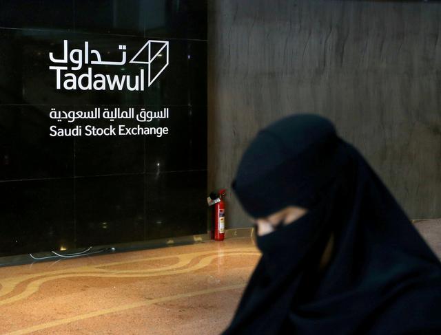 FILE PHOTO: Saudi woman walks at the Saudi stock market (Tadawul), in Riyadh, Saudi Arabia March 9, 2020.  REUTERS/Ahmed Yosri/File Photo