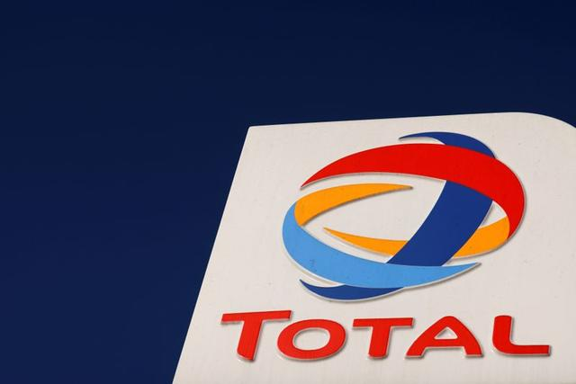 FILE PHOTO: The logo of French oil and gas company Total is seen at a petrol station in Neuville Saint Remy, France, October 1, 2020. REUTERS/Pascal Rossignol/File Photo