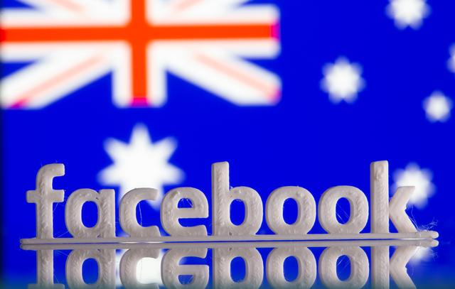 FILE PHOTO: A 3D printed Facebook logo is seen in front of displayed Australia's flag in this illustration photo taken February 18, 2021. REUTERS/Dado Ruvic/Illustration