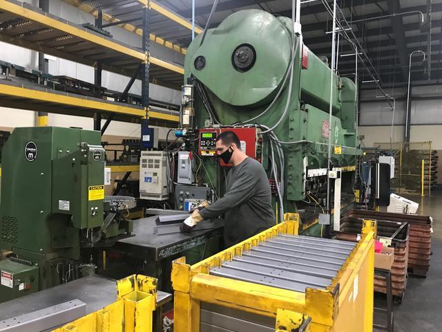 An operator stacks heavy gauge steel brace used for industrial workbench leg at Tennsco's factory  in Dickson, Tennessee, U.S. February 17, 2021. Tennsco/Handout via REUTERS