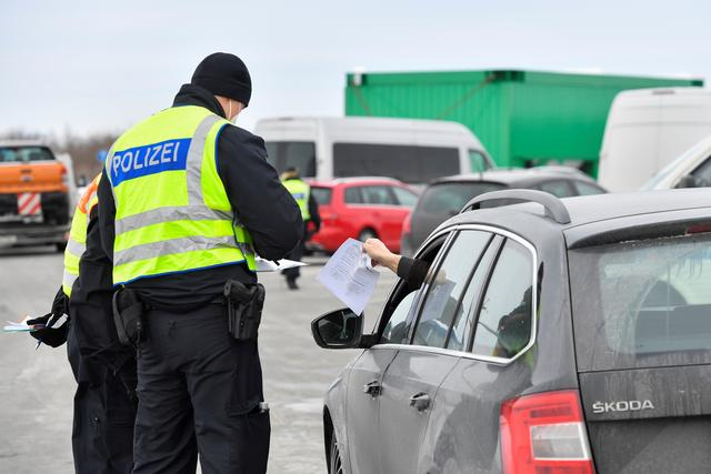 FILE PHOTO: German border police officers check a car at the A17 motorway near the Czech-German border, after controls between Germany and the Czech Republic have been re-established, as the spread of the coronavirus disease (COVID-19) continues, in Breitenau, Germany, February 15, 2021. REUTERS/Matthias Rietschel