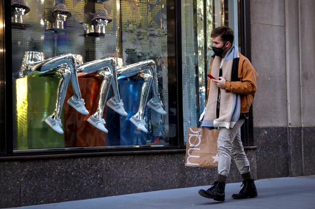 FILE PHOTO: A man shops, during the coronavirus disease (COVID-19) pandemic, on 5th Avenue in New York, U.S., February 17, 2021.  REUTERS/Brendan McDermid