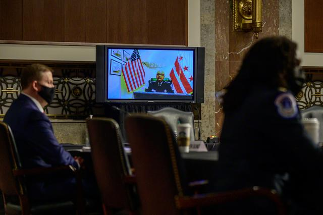 A screen shows Robert J. Contee III, Acting D.C. Metropolitan Police Chief, giving testimony during a Senate Homeland Security and Governmental Affairs and Senate Rules and Administration committees joint hearing on Capitol Hill, Washington, U.S. February 23, 2021, to examine the January 6th attack on the Capitol.    Erin Scott/Pool via REUTERS