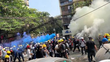 Video grab of protesters setting off smoke grenades to block the view from...