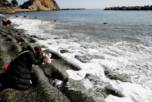 Ten years on, Japan mourns victims of earthquake and Fukushima disaster