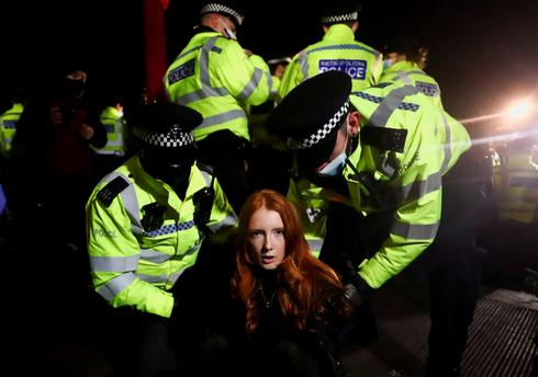 London police clash with mourners at vigil for murdered woman Sarah Everard
