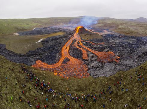 Thousands of curious onlookers flock to Iceland's erupting volcano