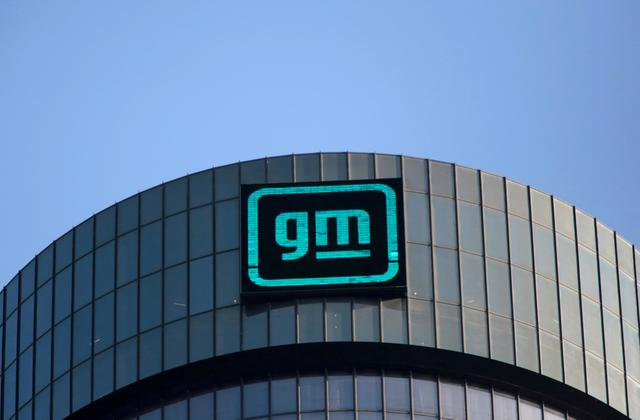 FILE PHOTO: The new GM logo is seen on the facade of the General Motors headquarters in Detroit, Michigan, U.S., March 16, 2021. REUTERS/Rebecca Cook