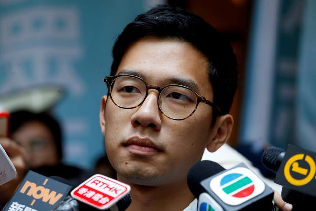 FILE PHOTO: Pro-democracy activist Nathan Law is interviewed by journalists outside the Final Court of Appeal after being granted bail in Hong Kong, China October 24, 2017.      REUTERS/Bobby Yip/File Photo