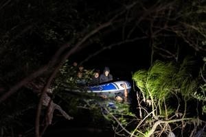 Migrants cross Rio Grande under cover of night