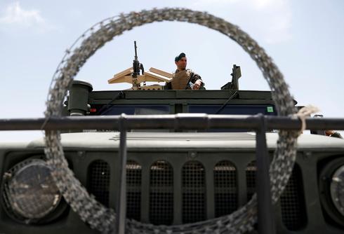 Bagram Air Base bustles as Afghans move in