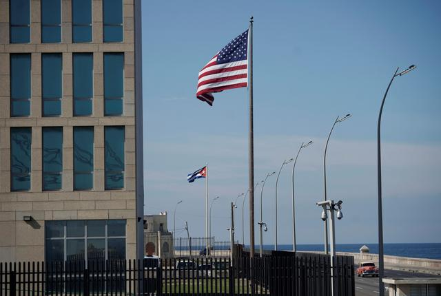 FILE PHOTO: A view of Cuban and U.S. flags beside the U.S. Embassy in Havana, Cuba, December 15, 2020. REUTERS/Alexandre Meneghini