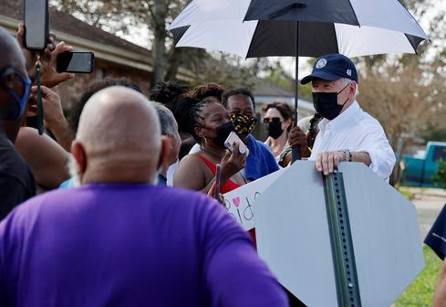 Biden visits hurricane-battered Louisiana