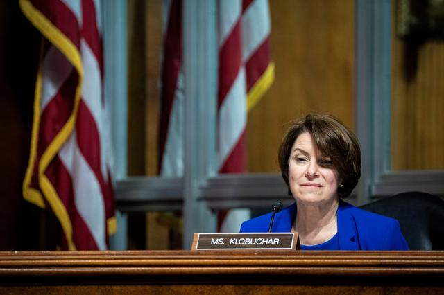 FILE PHOTO: U.S. Senator Amy Klobuchar listens during a hearing of the Senate Judiciary Subcommittee on Privacy, Technology, and the Law, in Washington, D.C., U.S., April 27, 2021. Al Drago/Pool via REUTERS/File Photo