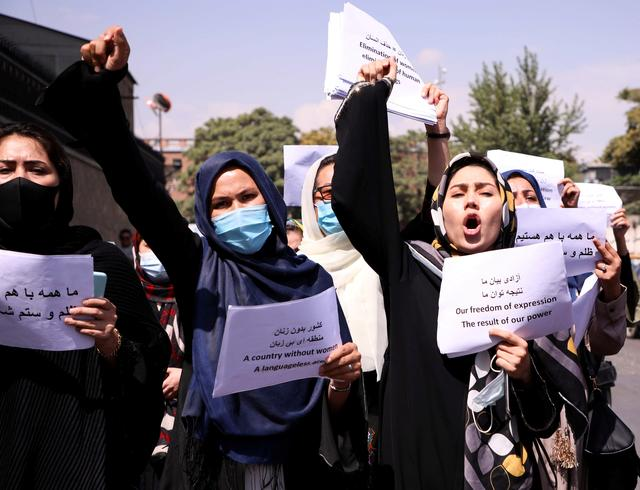 FILE PHOTO: Afghan women's rights defenders and civil activists protest to call on the Taliban for the preservation of their achievements and education, in front of the presidential palace in Kabul, Afghanistan September 3, 2021. REUTERS/Stringer/File Photo