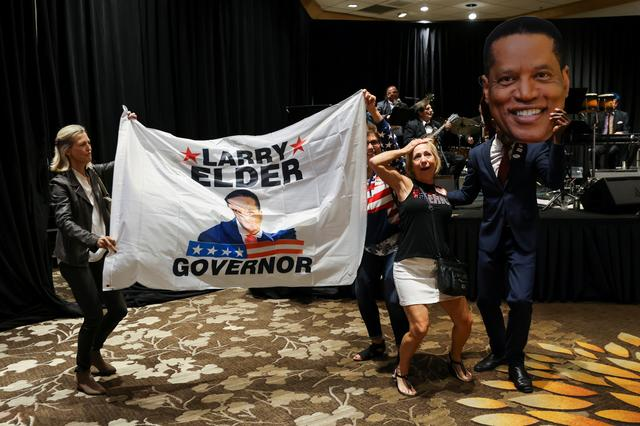 Supporters of Republican gubernatorial candidate Larry Elder gather on election night in Costa Mesa, California, U.S., September 14, 2021. REUTERS/Mike Blake