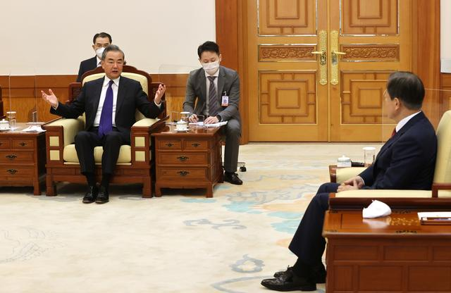 Chinese Foreign Minister Wang Yi speaks during a meeting with South Korean President Moon Jae-in at the Presidential Blue House in Seoul, South Korea, September 15, 2021.   Yonhap via REUTERS