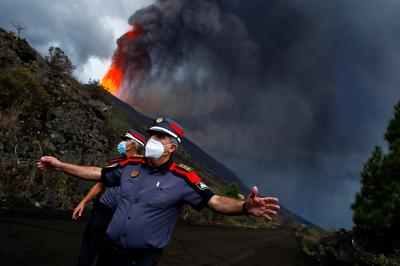In pictures: Thousands evacuate erupting volcano in Spain's Canary Islands