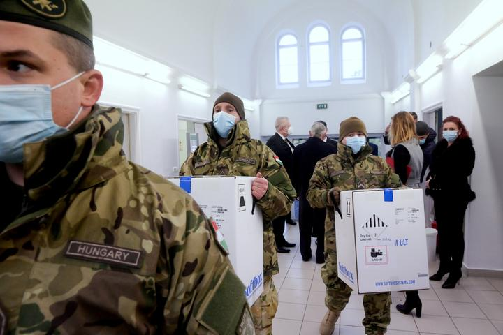 FILE PHOTO: Hungarian soldiers carry the first shipment of Pfizer-BioNTech...