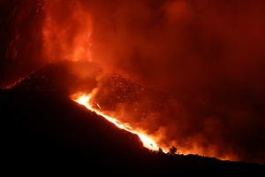 In pictures: La Palma volcano spews lava again after brief pause